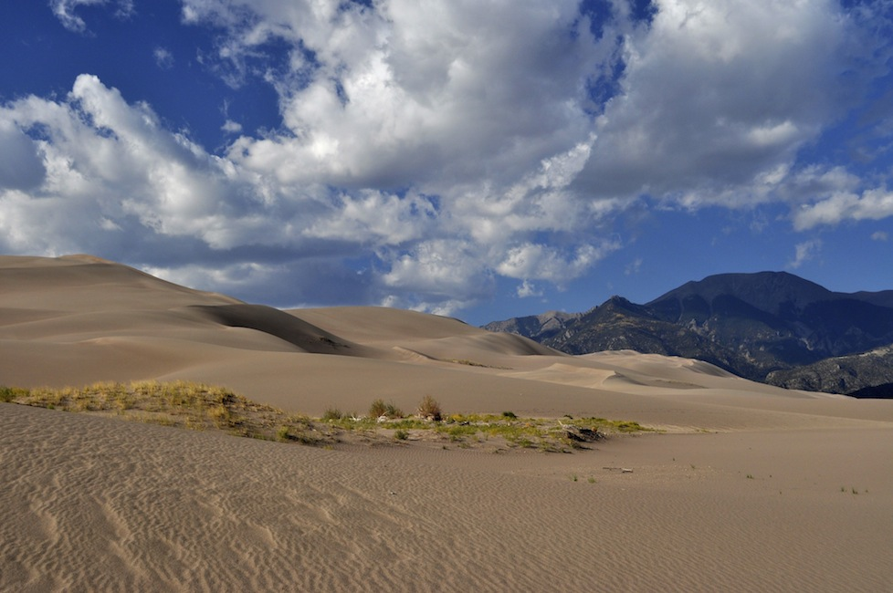 Alpine mountains and giant sand dunes side by side