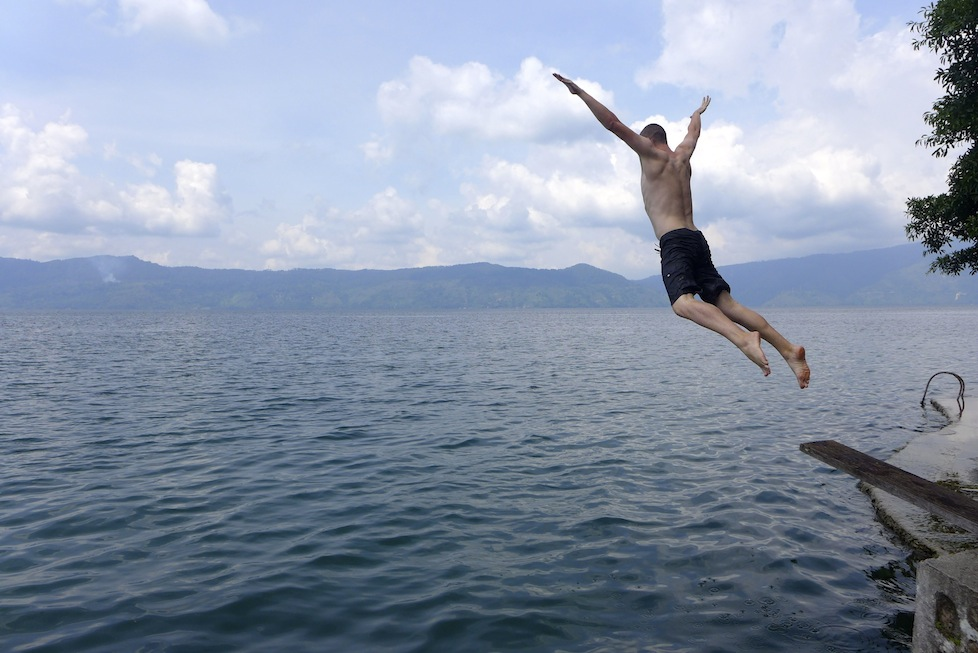 Paul taking a leap into volcanic Lake Toba