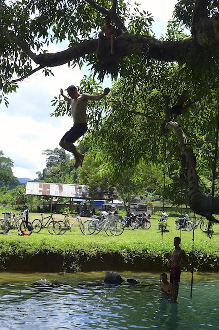 Paul leaping off the top branch at the Blue Lagoon, Vang Vieng
