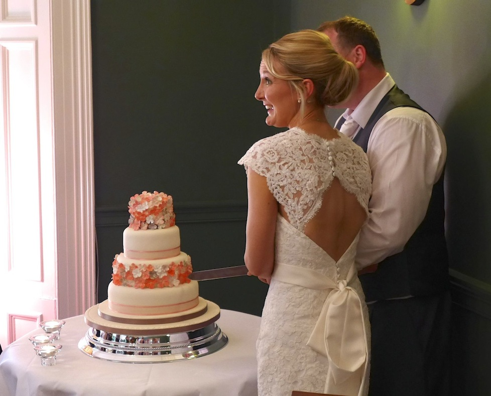 The gorgeous bridge and groom with their yummy cake