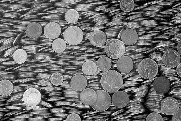 monochrome image of British coins